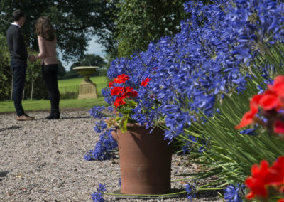 External Rear Garden - Couple Enjoying View Across Gardens