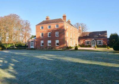House from croquet lawn in winter