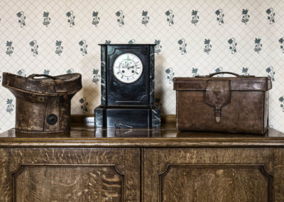 Cabinet in Bedroom with Clock and Leather Goods